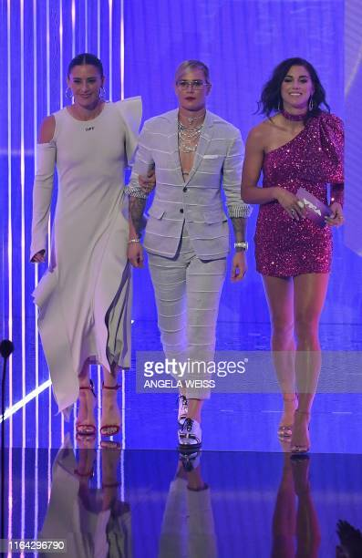 US soccer players Ali Krieger Ashlyn Harris and Alex Morgan walk on stage during 2019 MTV Video Music Awards at the Prudential Center in Newark New...