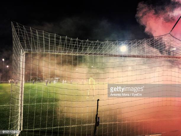 soccer players at stadium - soccer goal stock pictures, royalty-free photos & images
