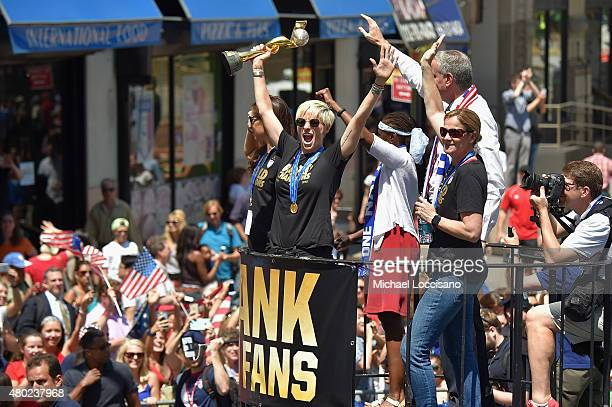 Soccer players Carli Lloyd and Megan Rapinoe Chirlane McCray Mayor Bill de Blasio and US Coach Jill Ellis aboard a float in the New York City Ticker...