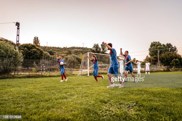 soccer players  celebrating a goal - football league stock pictures, royalty-free photos & images