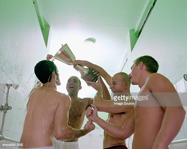 Soccer players celebrating in shower