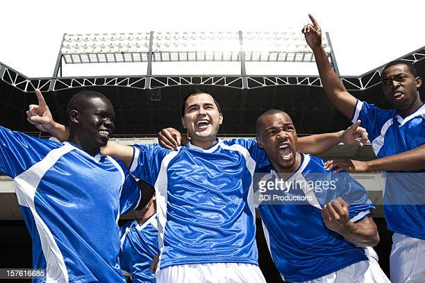 Soccer Players Celebrating Victory at the Stadium
