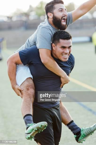 soccer players celebrating victory on field - cavalitas imagens e fotografias de stock