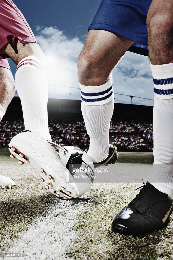 Soccer players competing for soccer ball : Stock Photo