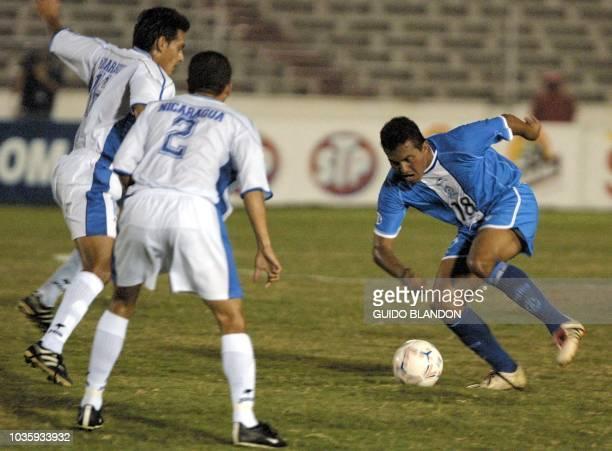 Soccer players César Alberto Alegría Rudel Alesandro Calero and Hevel Manuel Quintanilla are seen fighting for the ball in Panama City 18 February...