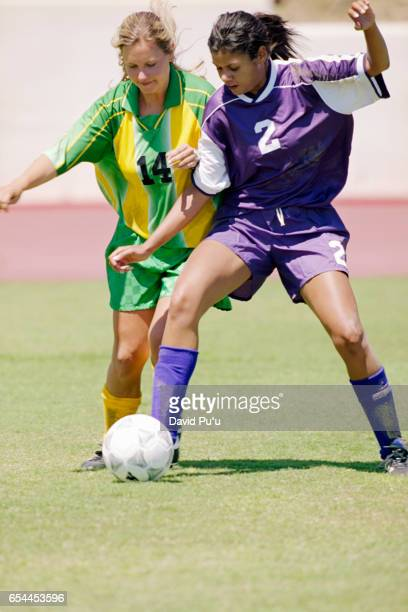 Soccer Players Fighting for Ball
