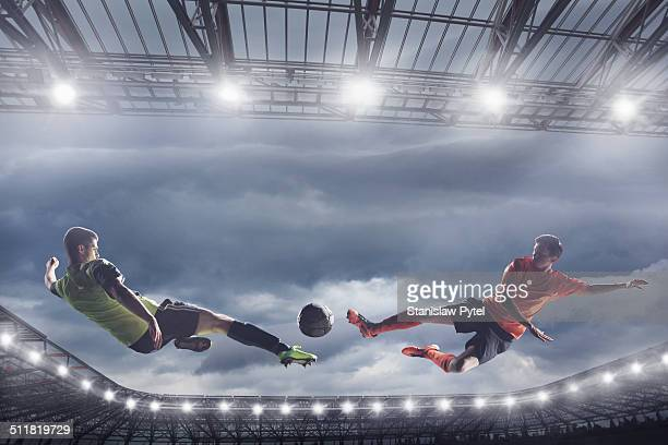 Soccer players fighting for the ball mid-air