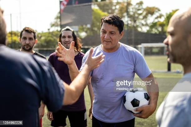 soccer players greeting opponent team players before start of the match - capitão de equipa imagens e fotografias de stock