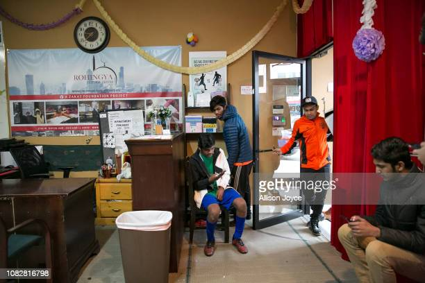 Soccer players hang out at the Rohingya Cultural Center of Chicago after a game January 12 2019 in Chicago Illinois Chicago has one of the largest...