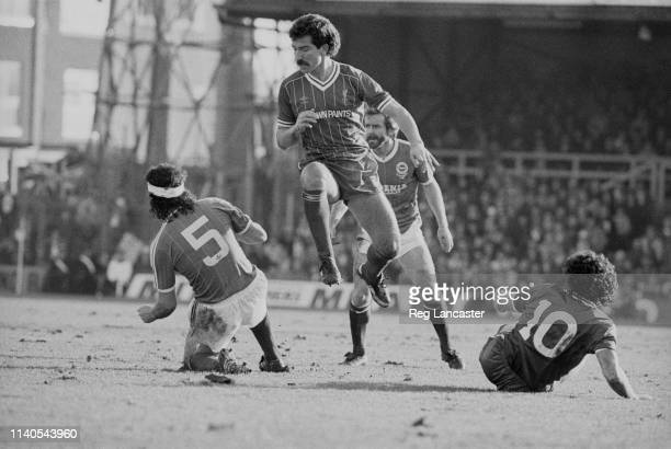 Soccer players in action during Brighton and Hove Albion v Liverpool match Brighton UK 29th January 1984 Graeme Souness centre jumping
