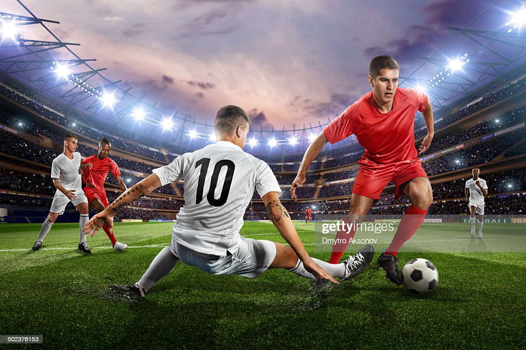 Soccer players in action on soccer stadium : Stock Photo