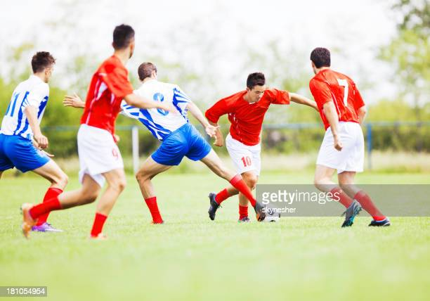 soccer players in action. - soccer striker stock pictures, royalty-free photos & images