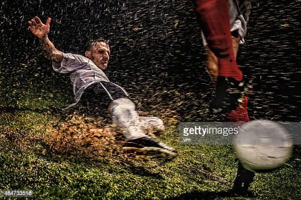 soccer players in action - tackling stock pictures, royalty-free photos & images
