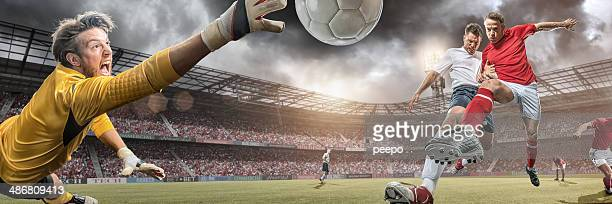 soccer players in action scoring goal - scoring a goal stock pictures, royalty-free photos & images