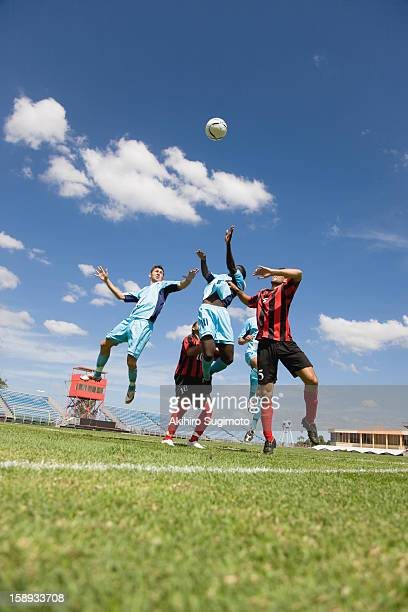 Soccer players jumping for header
