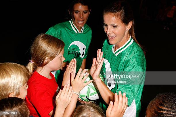 Soccer players Mia Hamm and Brandi Chastain teach children about soccer and flu vaccinations at Super Soccer Stars Indoor Soccer Field on August 20...
