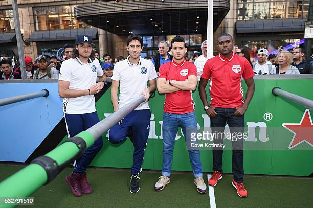 Soccer players Mix Diskerud Andoni Iraola Felipe Campanholi Martins and Chris Duvall attend the MLS Heineken Rivalry Week Human Foosball Soccer event...