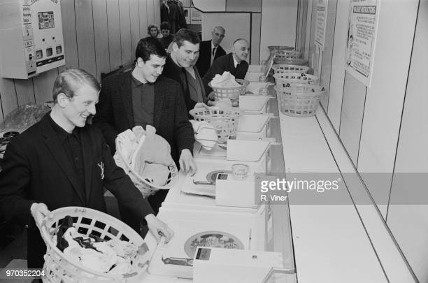 Soccer players of Nottingham Forest FC and Irish manager Johnny Carey doing their laundry at a launderette, UK, 14th January 1967.
