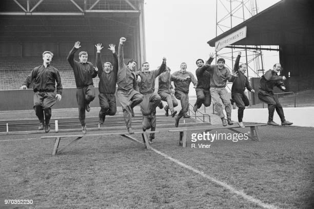 Soccer players of Nottingham Forest FC jumping from a bench, UK, 14th January 1967.