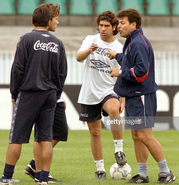 Soccer players on the chilean team George Garces and Marcelo Salas talk during training in the Couto Pereira Stadium in Curitiba in south Brazil 06...