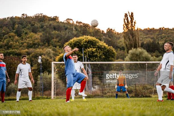 soccer players playing football - football league stock pictures, royalty-free photos & images