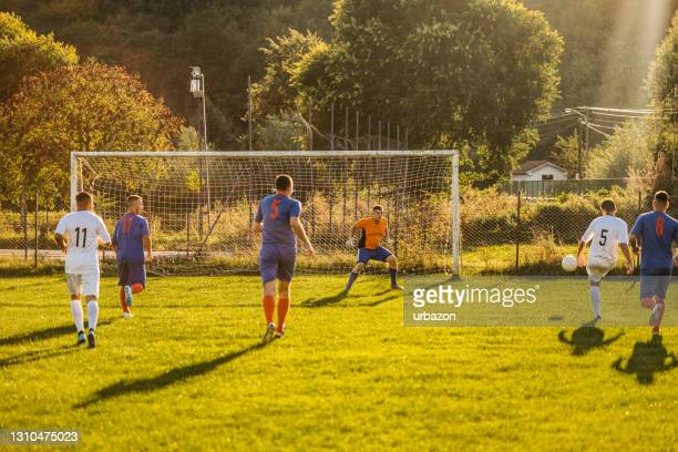 soccer players playing football - try scoring stock pictures, royalty-free photos & images