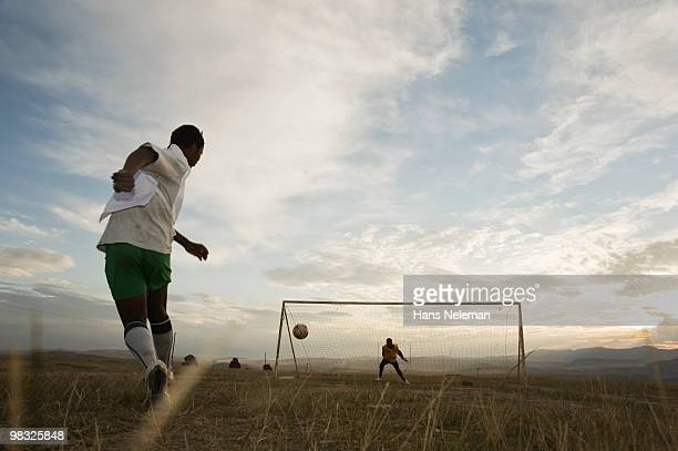 Soccer players playing in a field, South Africa