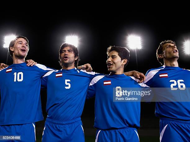 soccer players singing - football team stock pictures, royalty-free photos & images