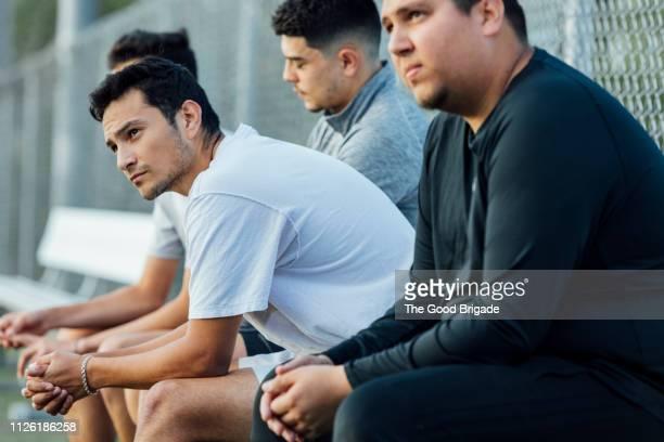 soccer players sitting on bench - 敗北 ストックフォトと画像