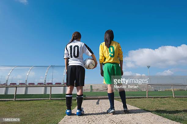 Soccer players standing in stadium