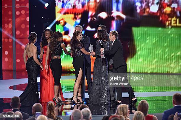 Soccer players Sydney Leroux Alex Morgan Hope Solo and Abby Wambach of The US Women's National Soccer team accept the award for Best Team from former...