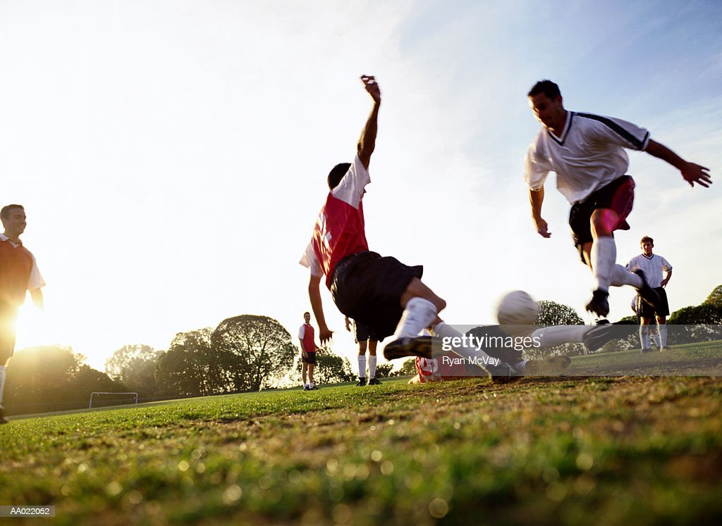 Soccer players tackling for ball, ground view : Stock Photo