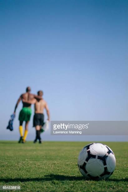 Soccer Players Walking off Field