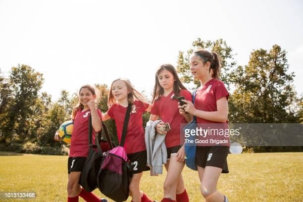 soccer players walking onto field - スポーツバッグ ストックフォトと画像