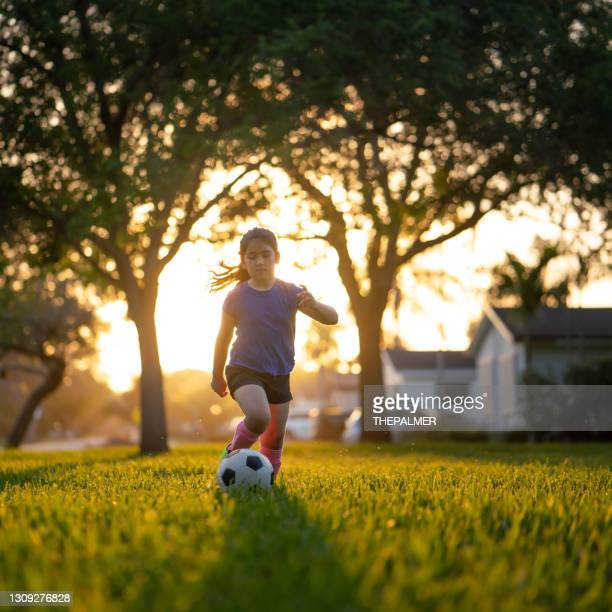 soccer practice in the park at sunset - football league stock pictures, royalty-free photos & images