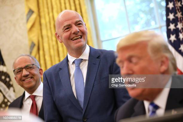 S Soccer President Carlos Cordeiro and FIFA President Gianni Infantino laugh as US President Donald Trump makes brief remarks to reporters during a...