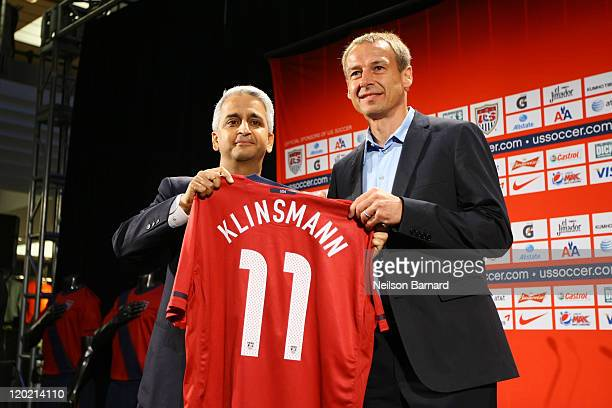 Soccer President Sunil Gulati and Juergen Klinsmann, the new head coach of the U.S. Men's National Team, hold up a jersey during a press conference...