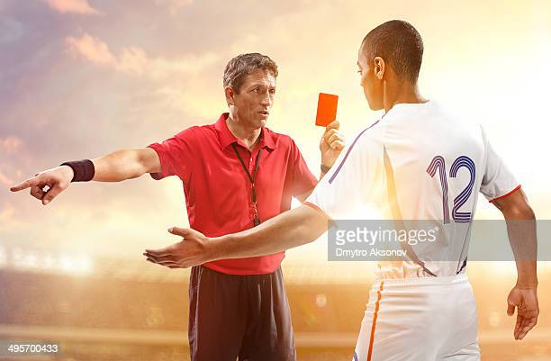 Soccer referee and football player