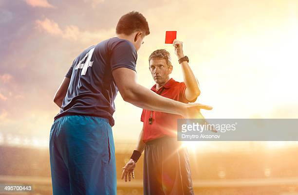 soccer referee and football player - referee stock photos and pictures