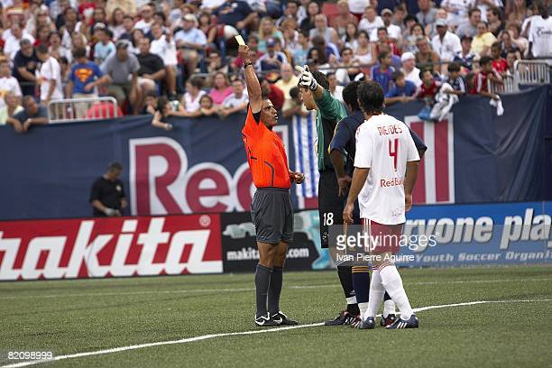 Referee Baldomero Toledo issuing yellow card to New York Red Bulls Jon Conway during game vs Los Angeles Galaxy. East Rutherford, NJ 7/19/2008...