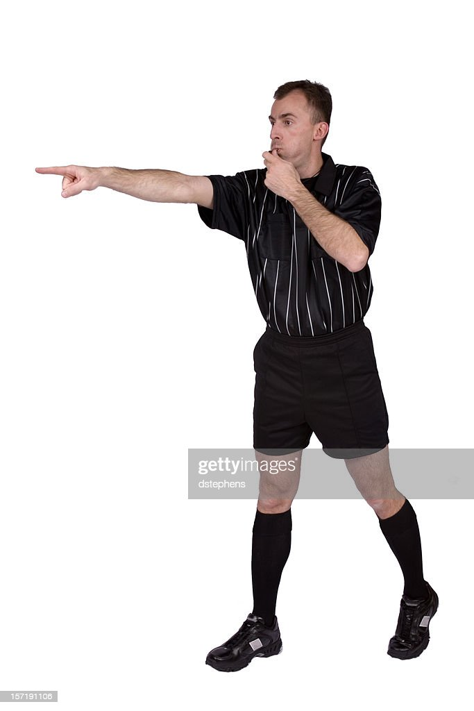 Soccer referee blowing whistle and  pointing : Stock Photo