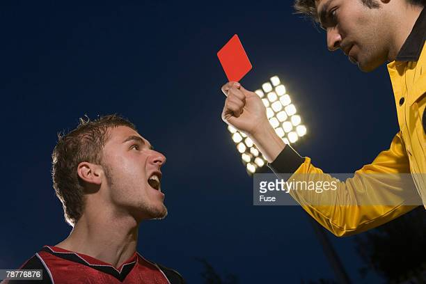 Soccer Referee Giving Red Card