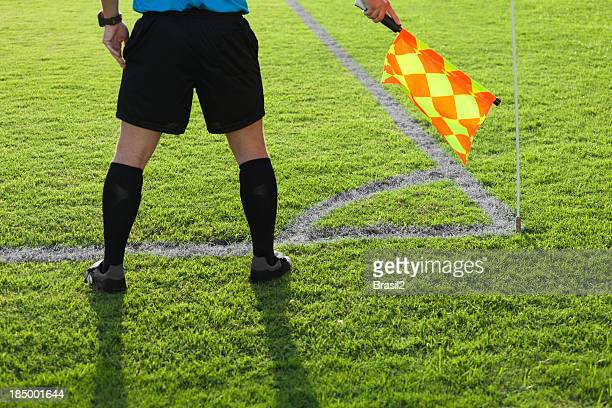 A soccer referee playing close attention on the aisle