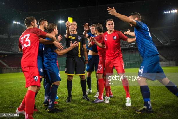 soccer referee showing yellow card - yellow card sport symbol stock pictures, royalty-free photos & images