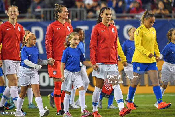 SheBelieves Cup USA Alex Morgan Ashlyn Harris and Sam Mewis holding hands with girls during line up vs Brazil before Group Stage match at Raymond...