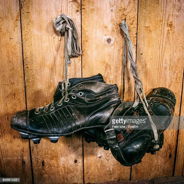 Soccer Shoes Hanging On Wooden Wall