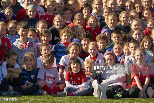 Sportsperson of the Year US Women's National Team and Reign FC forward Megan Rapinoe posing for group photo with children at youth soccer camp at...