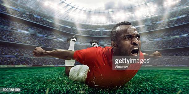 soccer stadium and soccer player happy after victory - personal accessory stock pictures, royalty-free photos & images