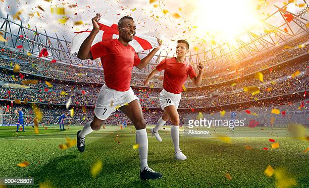 soccer stadium and soccer players are happy after victory - england football stock pictures, royalty-free photos & images