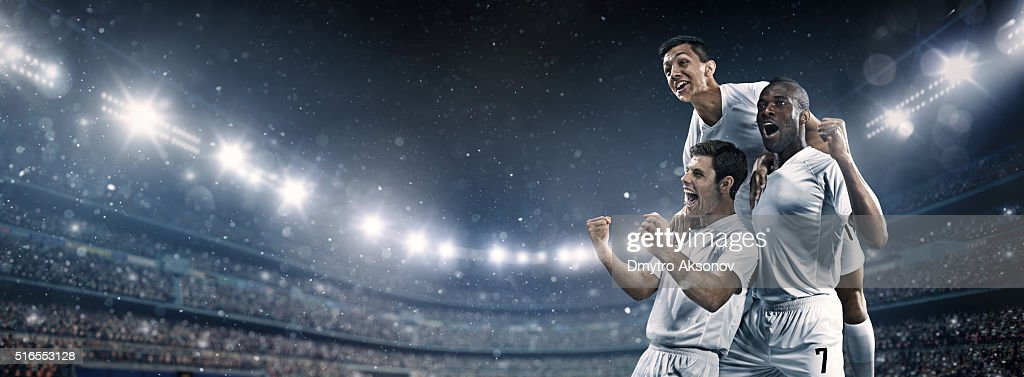 Soccer stadium and soccer players happy after victory : Stock Photo